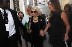 File photo of TV personality Joan Rivers and daughter Melissa Rivers leaving following a Spring/Summer 2013 collection show at New York Fashion Week September 10, 2012. REUTERS/Carlo Allegri/Files