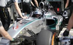 Mercedes Formula One driver Nico Rosberg of Germany is pushed back in the box during the second practice session of the Italian F1 Grand Prix in Monza September 5, 2014.  REUTERS/Max Rossi