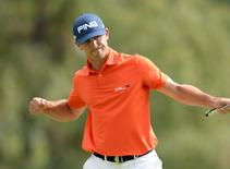 Sep 6, 2014; Cherry Hills Village, CO, USA; Billy Horschel reacts after sinking a birdie on the 18th green during the third round of the BMW Championship at Cherry Hills Country Club.  Ron Chenoy-USA TODAY Sports