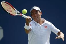 Kei Nishikori of Japan hits a return to Novak Djokovic of Serbia during their semi-final match at the 2014 U.S. Open tennis tournament in New York, September 6, 2014.         REUTERS/Ray Stubblebine