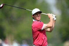 Sep 6, 2014; Cherry Hills Village, CO, USA; Rory McIlroy drives from 2nd tee during the third round of the BMW Championship at Cherry Hills Country Club. Mandatory Credit: Ron Chenoy-USA TODAY Sports
