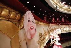A picture of Anna Nicole Smith hangs over one of the cherubs which decorate the balconies at the Royal Opera House, on the opening night of the opera based on her life, in central London, February 17, 2011. REUTERS/Andrew Winning