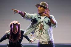 U.S. singer Pharrell Williams (R) performs on the Stravinski Hall stage at the 48th Montreux Jazz Festival in Montreux July 7, 2014. REUTERS/Jean-Christophe Bott/Pool
