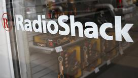 The exterior of a RadioShack store is seen in the Queens borough of New York in this March 4, 2014 file photos. Troubled electronics retailer RadioShack Corp said it may need to file for bankruptcy protection if its cash situation worsens, after reporting its tenth straight quarterly loss. REUTERS/Shannon Stapleton/Files  (UNITED STATES - Tags: BUSINESS LOGO)