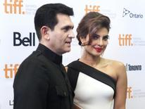 """Actress Priyanka Chopra and director Omung Kumar pose as they arrive for the premiere of the film """"Mary Kom"""" at the Toronto International Film Festival in Toronto, September 4, 2014.    REUTERS/Fred Thornhill"""