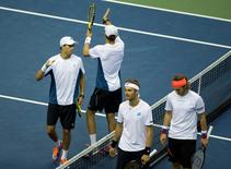 Sep 13, 2014; Chicago, IL, USA; Mike Bryan and Bob Bryan (USA) celebrate recording match point against Lukas Lacko and Norbert Gombos (SVK) in the Davis Cup doubles match at Sears Centre Arena. Susan Mullane-USA TODAY Sports