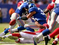 New York Giants safety Quintin Demps (35) fumbles the ball after being hit by Arizona Cardinals linebacker Kenny Demens (54) on a kickoff return during the fourth quarter at MetLife Stadium. Brad Penner-USA TODAY Sports
