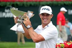 Sep 14, 2014; Atlanta, GA, USA; Billy Horschel holds up the FedEx Cup after the final round of the Tour Championship at East Lake Golf Club. Mandatory Credit: Jason Getz-USA TODAY Sports