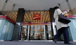 A pedestrian walks past a main branch of CIBC in  Montreal, April 24, 2014. REUTERS/Christinne Muschi