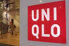 Shoppers walk inside Fast Retailing's Uniqlo casual clothing store in Tokyo July 10, 2014.  REUTERS/Toru Hanai