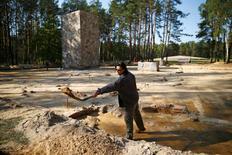 Archeologist and historian Anna Zalewska digs inside the perimeter of a Nazi death camp in Sobibor September 18, 2014.  REUTERS/Kacper Pempel