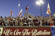 "Sacramento Republic FC fans known as ""The Battalion"" cheer during the team's game against Charleston Battery at Bonney Field, the team's home pitch, in Sacramento, California August 27, 2014.  REUTERS/Robert Galbraith"