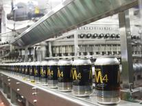 Cans of Molson beer are seen on a production line during a news conference in Montreal in this file photo taken March 19, 2012.  REUTERS/Christinne Muschi/Files