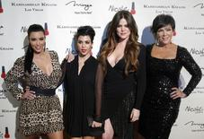 Television personalities (L-R) Kim Kardashian, Kourtney Kardashian, Khloe Kardashian and Kris Jenner arrive at the grand opening of the Kardashian Khaos store at the Mirage Hotel and Casino in Las Vegas, Nevada December 15, 2011. REUTERS/Las Vegas Sun/Steve Marcus