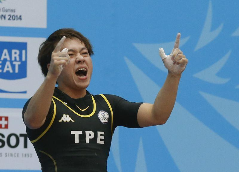 Taiwan's Lin Tzu Chi reacts after setting a new Asian Games record of 116kg  in the women's 63kg snatch weightlifting competition at the Moonlight  Festival ...