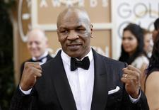 Boxer Mike Tyson arrives at the 71st annual Golden Globe Awards in Beverly Hills, California January 12, 2014. REUTERS/Mario Anzuoni