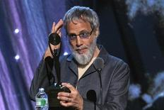 British singer-songwriter and humanitarian Yusuf Islam, commonly known by his former stage name Cat Stevens, touches his hair while looking at his reflection in his award, after he was inducted during 29th annual Rock and Roll Hall of Fame Induction Ceremony at the Barclays Center in Brooklyn, New York April 10, 2014. REUTERS/Lucas Jackson/Files