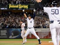 Sep 25, 2014; Bronx, NY, USA; New York Yankees shortstop Derek Jeter (2) celebrates hitting a walk-off single during the ninth inning against the Baltimore Orioles at Yankee Stadium. Robert Deutsch-USA TODAY Sports