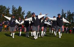 Team U.S. fans celebrate during the 40th Ryder Cup at Gleneagles in Scotland September 26, 2014. REUTERS/Eddie Keogh