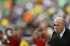 Fifa president Sepp Blatter takes his seat before the 2014 World Cup Group H soccer match between Belgium and Russia at the Maracana stadium in Rio de Janeiro June 22, 2014. REUTERS/Ricardo Moraes