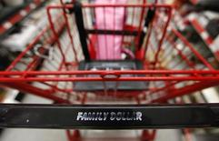 A Family Dollar logo is seen on a shopping cart in Chicago, June 25, 2012.  REUTERS/Jim Young