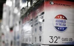 """An """"Assembled in the USA"""" stamp is seen at the side of a box containing a 32-inch television set in the warehouse of Element Electronics, in Winnsboro, South Carolina in this file photo taken May 29, 2014.  . REUTERS/Chris Keane/Files"""