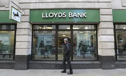 A man walks past a branch of Lloyds bank in central London February 13, 2014.REUTERS/Paul Hackett