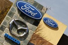 The logos of Ford and Mazda Motor Co are seen at the company's assembly plant in Pretoria July 18, 2014.  REUTERS/Siphiwe Sibeko