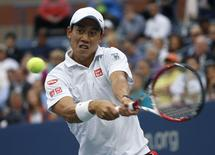 Kei Nishikori of Japan hits a return to Marin Cilic of Croatia during their men's singles final match at the 2014 U.S. Open tennis tournament in New York, September 8, 2014.    REUTERS/Mike Segar