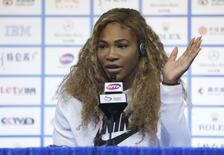 Serena Williams of the U.S. answers a question at a news conference at the China Open tennis tournament in Beijing, October 3, 2014. REUTERS/Jason Lee