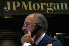 JPMorgan Chase trader Frederick Reimer works in the company's stall on the floor of the New York Stock Exchange August 28, 2014. REUTERS/Brendan McDermid