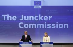 Jean-Claude Juncker (L), the incoming president of the European Commission (EC), presents the list of the European Commissioners and their jobs for the next five years, as EC spokesperson Natasha Bertaud looks on during a news conference at the EC headquarters in Brussels September 10, 2014.  REUTERS/Yves Herman
