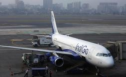 An IndiGo Airlines Airbus A320 aircraft is pictured parked at a gate at Mumbai's Chhatrapathi Shivaji International Airport February 3, 2013. REUTERS/Vivek Prakash/Files