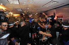 Oct 5, 2014; Kansas City, MO, USA; The Kansas City Royals celebrate in their locker room after defeating the Los Angeles Angels in game three of the 2014 ALDS baseball playoff game at Kauffman Stadium. The Royals won 8-4 advancing to the ALCS against the Baltimore Orioles. Mandatory Credit: John Rieger-USA TODAY Sports