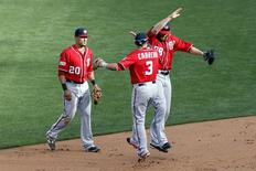 Oct 6, 2014; San Francisco, CA, USA; Washington Nationals right fielder Jayson Werth (28) second baseman Asdrubal Cabrera (3) and Washington Nationals shortstop Ian Desmond (20) cerebrate after beating the San Francisco Giants 4-1 in game three of the 2014 NLDS baseball playoff game at AT&T Park. Mandatory Credit: Kelley L Cox-USA TODAY Sports