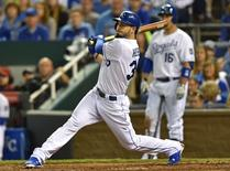 Oct 5, 2014; Kansas City, MO, USA; Kansas City Royals first baseman Eric Hosmer (35) watches his two-run home run against the Los Angeles Angels during the third inning in game three of the 2014 ALDS baseball playoff game at Kauffman Stadium. Mandatory Credit: Peter G. Aiken-USA TODAY Sports