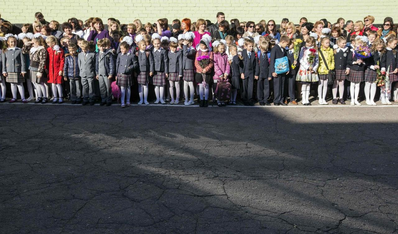 Back to school in rebel east Ukraine - to the sound of bombs and
