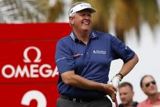 Colin Montgomerie of Britain watches his shot from the third tee during the first round of the Omega Dubai Desert Classic at the Emirates Golf Course in Dubai February 9, 2012. REUTERS/ Nikhil Monteiro