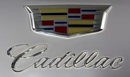 A Cadillac logo is pictured at the Jacob Javits Convention Center during the New York International Auto Show in New York April 16, 2014.  REUTERS/Carlo Allegri