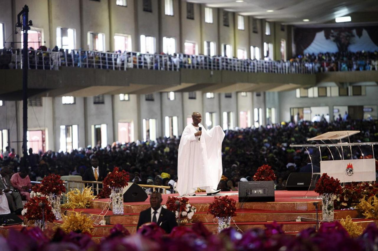Bishop david oyedepo c founder of the living faith church also known as the winners chapel conducts a service for worshippers in the auditorium of the