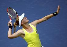 Alison Riske of the U.S. serves to Ana Ivanovich of Serbia during their match at the 2014 U.S. Open tennis tournament in New York, August 26, 2014.    REUTERS/Adam Hunger