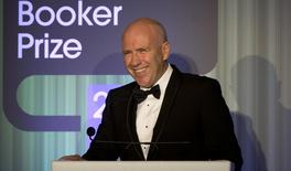 """Australian author Richard Flanagan, who wrote """"The Narrow Road to the Deep North"""", speaks after winning the 2014 Man Booker Prize for Fiction at the Guildhall in London, October 14, 2014. REUTERS/Alastair Grant/Pool"""