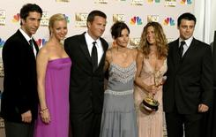 "The cast of ""Friends"" appears in the photo room at the 54th annual Emmy Awards in Los Angeles September 22, 2002. REUTERS/Mike Blake"