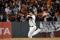 Oct 16, 2014; San Francisco, CA, USA; San Francisco Giants left fielder Travis Ishikawa (45) runs the bases after hitting a walk off three run home run against the St. Louis Cardinals during the ninth inning of game five of the 2014 NLCS playoff at AT&T Park. Mandatory Credit: Kyle Terada-USA TODAY Sports