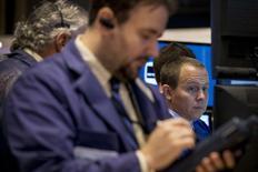 Traders work on the floor of the New York Stock Exchange October 17, 2014. REUTERS/Brendan McDermid