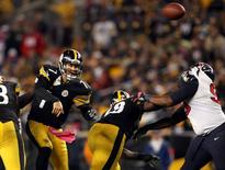 Pittsburgh Steelers quarterback Ben Roethlisberger (7) throws a pass under pressure against the Houston Texans during the second half at Heinz Field.  Jason Bridge-USA TODAY Sports