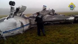 An investigator looks at the wreckage of Christophe de Margerie's Dassault Falcon jet at Moscow's Vnukovo airport in this still image taken from video, October 21, 2014.  REUTERS/Russian Investigative Committee/Handout via Reuters TV