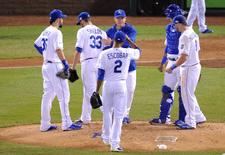 Oct 21, 2014; Kansas City, MO, USA; Kansas City Royals starting pitcher James Shields (33) is relieved by manager Ned Yost (middle rear) in the fourth inning against the San Francisco Giants during game one of the 2014 World Series at Kauffman Stadium. Mandatory Credit: Christopher Hanewinckel-USA TODAY Sports