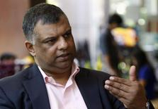 Tony Fernandes, CEO of AirAsia, gestures during an interview with Reuters at the sidelines of the World Economic Forum on East Asia, in Manila's Makati financial district May 22, 2014. REUTERS/Erik De Castro