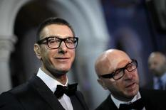 Italian designers Stefano Gabbana (L) stands next to Domenico Dolce as they talk to the media during a party marking the 25th anniversary of British model Naomi Campbell career in downtown Shanghai October 28, 2010.  REUTERS/Carlos Barria